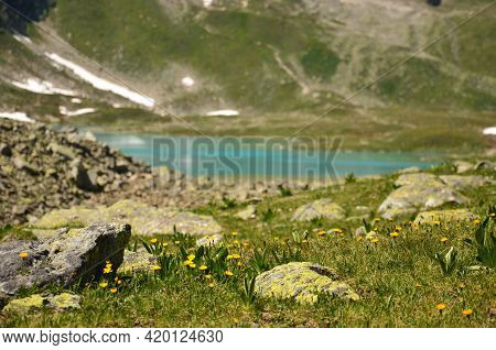 Swiss Mountain Lake In The Canton Of Grisons. Beautiful Hiking Landscape In The Mountains With Lakes