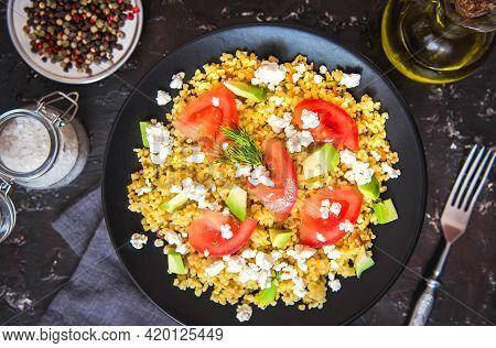 Fresh Bulgur Porridge With Tomatoes, Avocado And Feta Cheese. Vegetarian Salad With Bulgur.