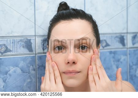 Portrait Of Young Woman Is Applying Hyaluronic Acid On Face Skin Taking A Bath With Foam. Rejuvenati