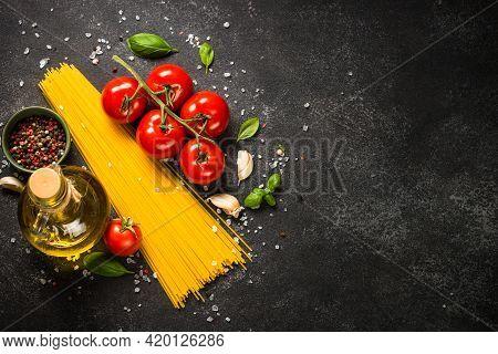 Pasta Background. Pasta Spaghetti, Olive Oil, Basil And Fresh Tomatoes.