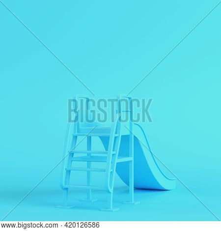 Children Slide On Bright Blue Background In Pastel Colors. Minimalism Concept. 3d Render