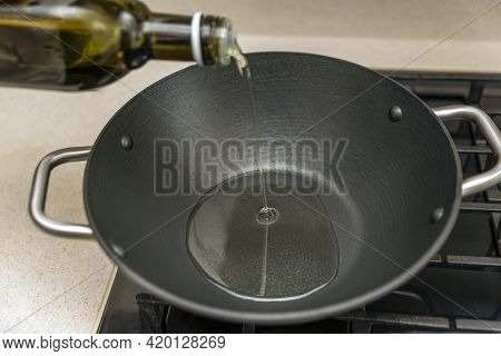 Cooking Pilaf In A Cauldron, A Recipe For Real Pilaf. Grape Seed Oil For Cooking Pilaf, Pour Oil Int
