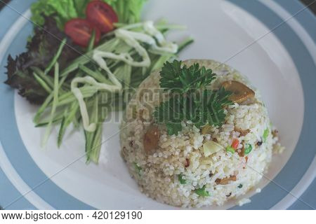 Traditional Malaysian Cuisine Withe Rice And Salad