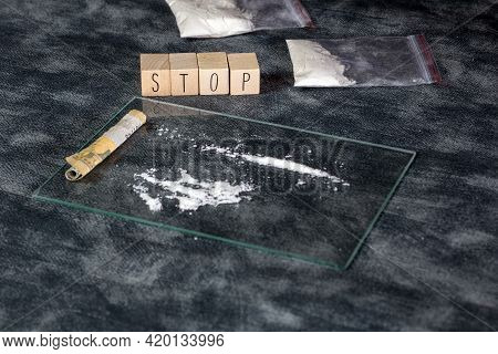 Drugs Addiction, White Powder Line,cocaine,speed Or Other Drugs And Syringe With Heroin And The Text