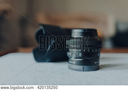 London, Uk - May 07, 2021: Close Up Of A Sony 40mm Compact Lens In Front Of A Regular Size Prime Len