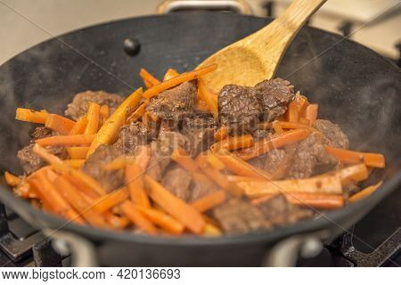 Cooking Pilaf In A Cauldron. A Step By Step Recipe For Cooking Pilaf, Cut The Beef Into Pieces And F
