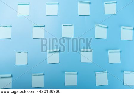Lots Of Blank Stickers. Blue Stickers On A Blue Background. Background From Stickers. Flat Lay.
