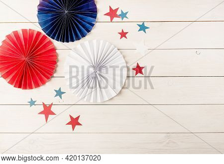 Decorations For 4Th July, Independence Day Usa. Paper Fans And Stars On White Wooden Background