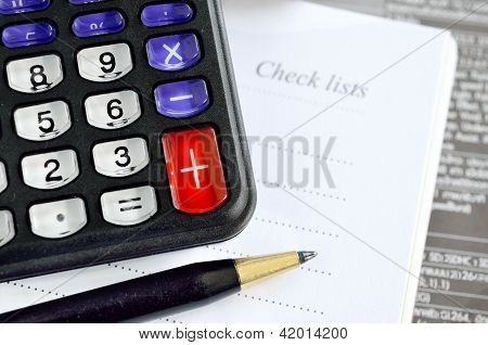 Pen, Calculator And Notebook