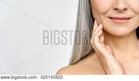 Senior Older Middle Aged Asian Womans Radiant Face With Perfect Skin. Advertising Of Antiaging Anti