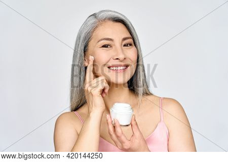 Mature Beautiful Happy Middle Aged Asian Woman, Older Grey Haired Lady Looking At Camera Touching Fa