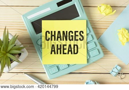 Text Changes Ahead On White Paper Sheet And Brown Paper Notepad On The Table With Diagram. Business