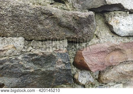 Fragment Of Large Natural Stone Masonry. Abstract Background.