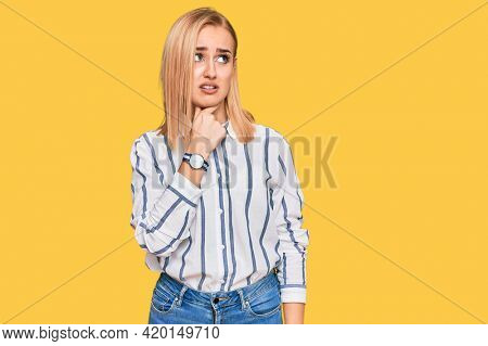 Beautiful caucasian woman wearing casual clothes touching painful neck, sore throat for flu, clod and infection