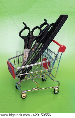 Hairdressing Scissors And Comb In A Shopping Trolley On Green Background
