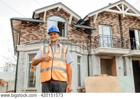 Smiley Asian Worker Builder Man Or Civil Engineer Man With Protective Safety Helmet And Reflective V