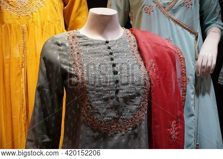 Indian Woman Latest Fashion Dress Hung On Hangers ,in Display In A Retail Shop,in Market. Indian Pak