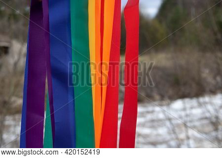 Bright Rainbow Ribbons On The Background Of A Spring River.carnival Ribbons. Lgbt Symbol.