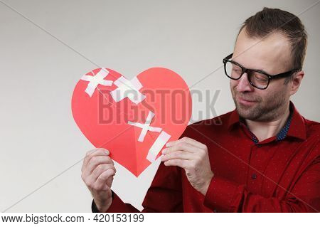 Bad Relationships, Breaking Up, Sadness Emotions Concept. Sad Adult Man Holding Broken Heart Fixed W