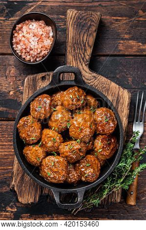 Meatballs In Tomato Sauce From Beef And Pork Meat With Thyme In Rustic Pan. Dark Background. Top Vie