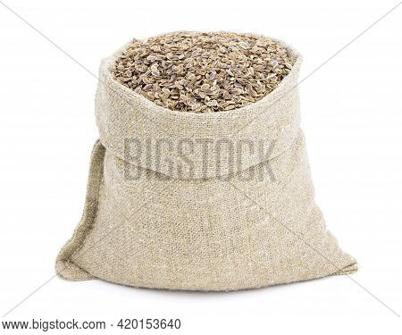 Seeds Of Dill In A Sack Of Isolated On A White Background. Fennel. Dill In A Burlap Sack. Healthy Fo
