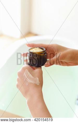 Closeup Shot Of Beautiful Female Hands Applying Moisturiser. Beauty Womans Hand Applying Cream