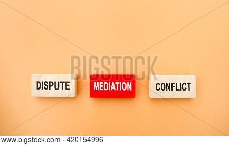 Wooden Blocks With The Word Dispute, Mediation, Conflict. Settlement Of Disputes By Mediation. Dispu