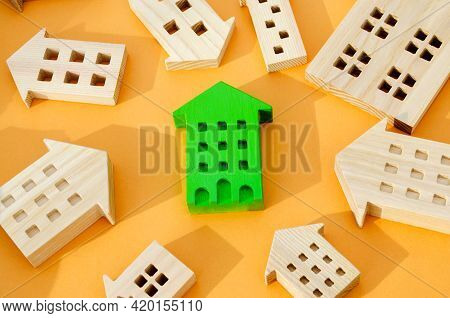 Many Miniature Wooden Houses. Real Estate Concept. Choose Affordable Housing. Buying And Selling Hou