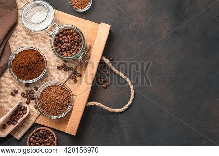Grain, Ground And Instant Coffee On A Brown Background. Top View, Copy Space.