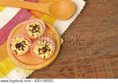 Malaysian Homemade Cookies Called As Kuih Sarang Semut With Chocolate Rice On Wooden Plate Served Du