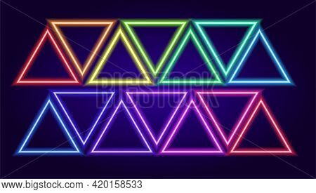 Vector Set Of Neon Colored Triangles. Isolated Elements In The Form Of Neon Triangular Frames Multic