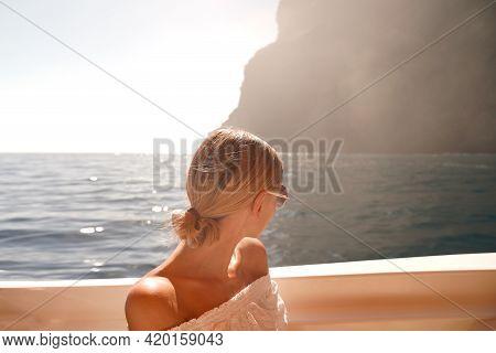 Joyful Woman On Sailing Boat Discovering Island Coast On Summer Cruise.