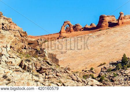 Delicate Arch. The beauty of Arches Park in USA. Picturesque red-brown sandstone cliffs form a unique landscape. Grandiose rock compositions natural origin.