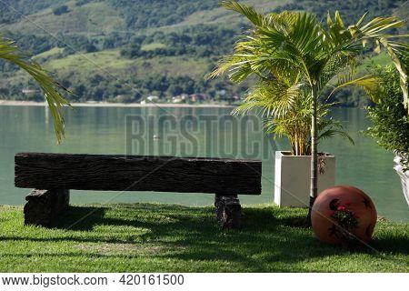 Old Wooden Bench With View To The Sea Of Angra Dos Reis Rio De Janeiro Brazil.