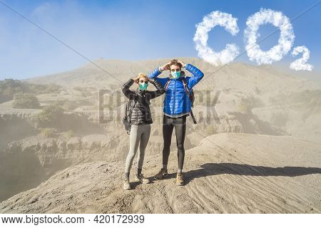 Young Couple Man And Woman Scared Of Co2 Lettering Made Of Clouds. Sky With Co2 Pollution, Smog