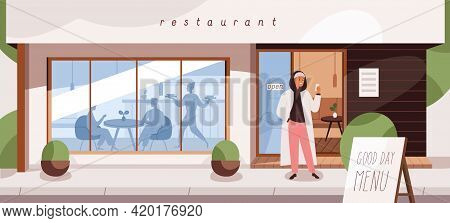 Restaurant Exterior With People Inside And Outside. Happy Smiling Man On Street Near Open Cafe Takin