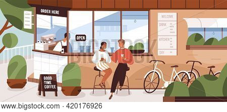 Happy Modern People Sitting On Chairs At Street Kiosk Or Coffee Shop. Couple With Bicycles Resting N