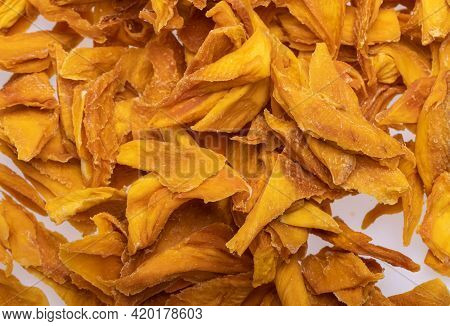 Dried Mango Slices. Perfect As A Snack, Addition To Ice Cream And Other Desserts.