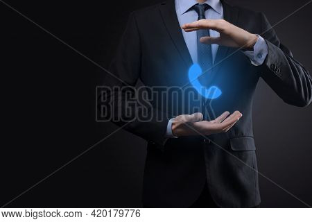 Businessman Man In Suit On Black Background Hold Phone Icon.call Now Business Communication Support