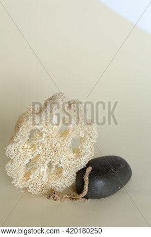 Bath Accessories Concept. Natural Beige Sponge Luffa Cylindricaon On Neutral Beige Background. Zero