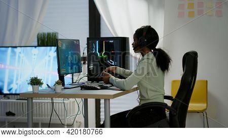 Black Woman Gamer Winning Videogames Using Professional Wireless Controller
