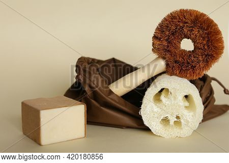 Bath Accessories Concept. Natural Beige Sponge Luffa Cylindricaon With Eco Toilet Cleaner Tool On Ne