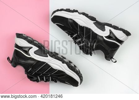 Stylish Women's Sneakers On A White And Pink Backgrounds. Women's Sports Shoes
