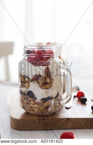 Homemade Granola Or Oatmeal Granola With Yoghurt And Fresh Berries. Perfect Vegetarian Or Vegan Brea