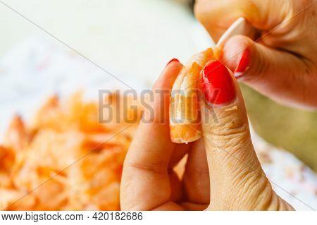 Seafood, Ocean Food. Female Hands Peeling Raw Fresh Shrimps. Preparing For Cooking Prawn.