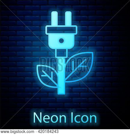 Glowing Neon Electric Saving Plug In Leaf Icon Isolated On Brick Wall Background. Save Energy Electr