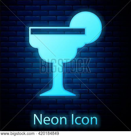 Glowing Neon Margarita Cocktail Glass With Lime Icon Isolated On Brick Wall Background. Vector