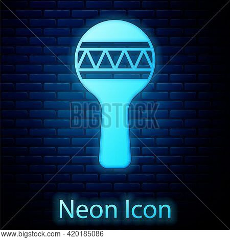 Glowing Neon Maracas Icon Isolated On Brick Wall Background. Music Maracas Instrument Mexico. Vector