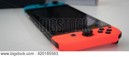 Nintendo Switch video game console developed by Nintendo, released on March 3, 2017 on a white background. Germany, Berlin - June 30, 2019: Nintendo Switch Joy-con controller on a white background