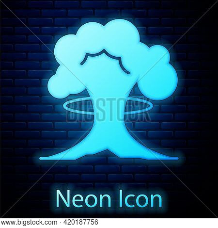 Glowing Neon Nuclear Explosion Icon Isolated On Brick Wall Background. Atomic Bomb. Symbol Of Nuclea
